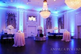blue uplighting by beyond creates a fun atmosphere for this wedding in dallas tx held