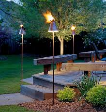 lighting tiki torches. View In Gallery Elevate The Entryway With Trendy Tiki Torches This Cold Winter Lighting