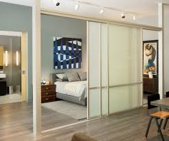 view in gallery separation with sliding glass doors and rail lighting for the bedroom