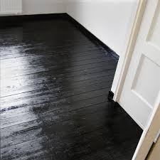painted black floors simple and fresh fix to damaged wood floors when sanding and staining are not an option