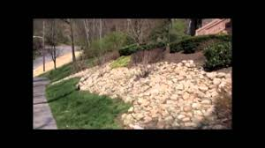 Video showing a slope landscaped with natural stone and shrubs. Nashville- landscaping-slope-hill.mp4 - YouTube