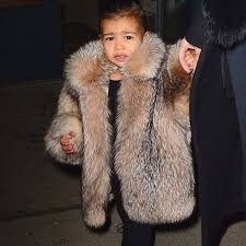 north west wearing expensive coat