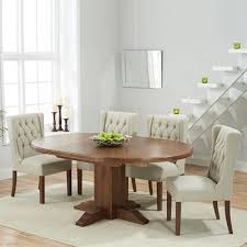 trina dark solid oak round extending dining table with 6 sophia beige chairs 7236