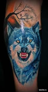 татуировка скалящийся волк в лесу Tatufotocom