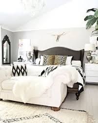 beautiful bedroomlove black white tan. neutral but bold and beautiful bedroom with beni ourain rug leather studded bed brass longhorn skull black white accents master bedroomlove tan d