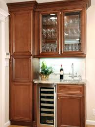 brown polished wooden built in small kitchen cabinet with fridge and storage drawer plus mini singapore