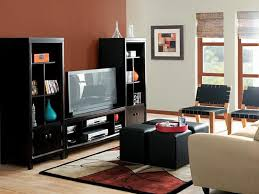 a minimalist black furniture design with red room color decorations and dark lacquered black furniture what color walls