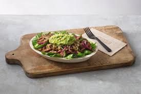 paleo salad bowl on a wooden board