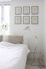 Homevialaura | White bedroom with Artemide Tolomeo lamps, linen ...