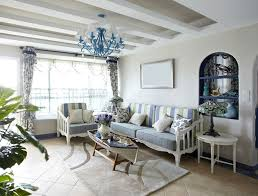 unique coffee table and green blue and white stripe sofas on soft brown rug with blue