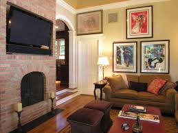 cozy paint colors for living room decorations with red brick fireplace under wall tv using wood flooring ideas