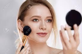 Closeup Woman Holding Mirror Applying Makeup Compact Powder Stock
