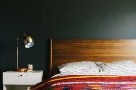 this bedroom in a writer s desert retreat is painted a dark gray shade from behr to create a den like effect