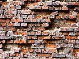 old broken brick wall stock photo