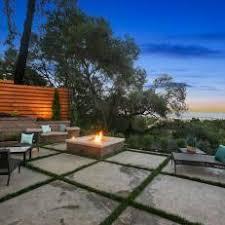 patio with square fire pit. Concrete Grid Patio With Square Fire Pit And Brown Wicker Furniture