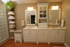 towel storage. Bathroom:Excellent White Bathroom Design With Neat Looking Towel Storage And Laminated Wooden Flooring O