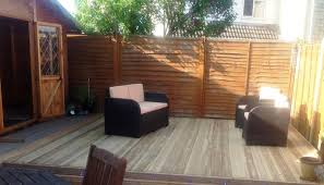 patio deck kits with wooden deck pattern and white cushion patio chairs
