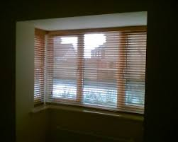 Wooden Venetian Blinds Installed In Square Bay Window  New Home Bay Window Vertical Blinds