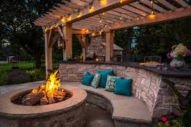 outdoor stone kitchen design with pool