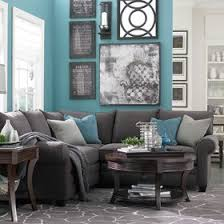 Thinkin of doing these color in one of the living rooms.. turquoise and grey  with all black and write pictures of the family | Pinterest | Living room  ...