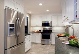 furniture grey granite countertops added by white wooden kitchen cabinet and stainless refrigerator on beige
