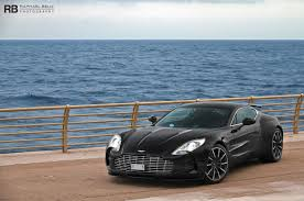 aston martin one 77 black. black aston martin one77 front three quarters one 77 o