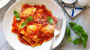 Chicken and Mushroom Ravioli with Simple Tomato Sauce Recipe | myfoodbook |  Homemade fresh egg pasta with cream, mushrooms and chicken mince