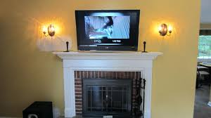 tv mount over fireplace pull down into brick above mantel