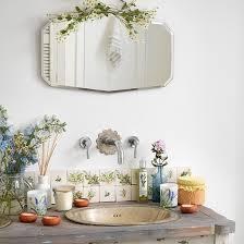 vintage bathroom designs. vintage basin and taps with bevelled mirror bathroom designs