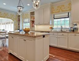 white kitchen cabinets with tan brown granite