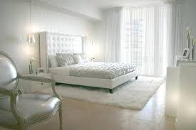 rug under bed hardwood floor. Fur Rug Bedroom Beautiful White Design With High Headboard And On Wooden Floor . Under Bed Hardwood A