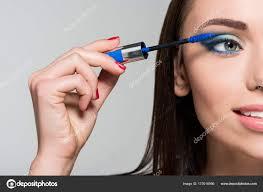 woman doing eyelashes makeup stock photo