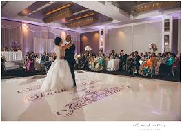 venue style modern luxury hotel catering choices on site plated buffet or stations special features vaulted ceilings modern chandeliers