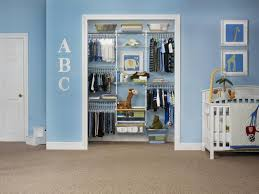 blue sky wall and cute baby closet organizer with cloth hanging areas and sweet transpa