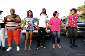 essay faith out works is dead nbc news image a group of protesters demonstrate near a prayer vigil in memory of alton sterling