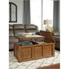 t830 9 ashley furniture tamonie medium brown living room cocktail table