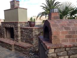 a beautiful wood fired brick pizza oven fireplace combination in sunny ca the oven was built using the mattone barile diy pizza oven foam form