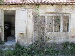 wide open doors. Abandoned And Ruined Small House Covered With Ivy Wide Open Doors Stock Photo - 50657468