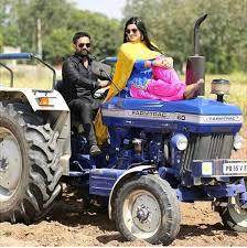 punjabi couple on tractor 480x481