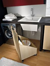 this diy pallet wood storage bin with wheels provides movable storage under the sink