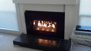 electric fireplace insert with black frame and white wall and ceramics floor for warm room ideas