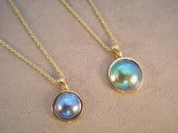 18ct yg blue pearl pendants 15mm 2105 12mm 1500