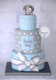 A Baby Boy Blue And Grey Baby Shower Cake Based On A Design By Cake