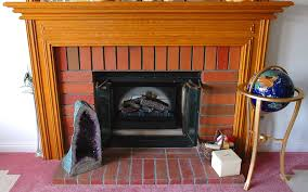 cozy space using dimplex electric fireplace insert wood fireplace surround and brick with dimplex electric