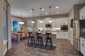kolter homes kitchen featuring archie pendants over island