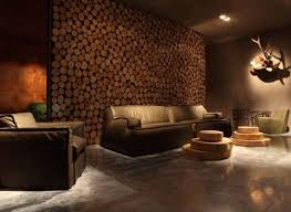 Living room accent wall made of wooden logs