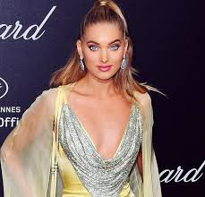 elsa hosk makeup hairstyle at ces 2018 with light yellow dress at chopard night with cape