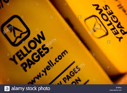 yellow pages telephone directory showing close up of logo and address stock image