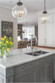white kitchen cabinets and black appliances