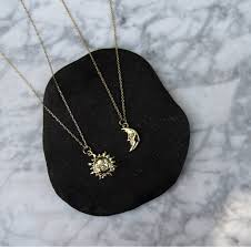 sun moon necklace gold sun face crescent moon phase jewelry with meaning